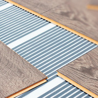 Laminate underfloor heating: installation and installation of a film infrared system