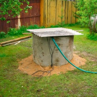 A do-it-yourself well in a country house: a guide for arranging a typical well from rings