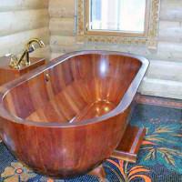Salle de bain dans une maison en bois: les règles d'aménagement et les caractéristiques de la décoration