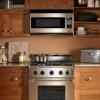 Is it possible to hang a microwave over a gas stove: safety requirements and basic installation rules