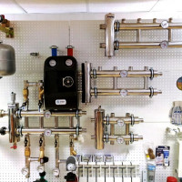 Natural circulation heating system: common water circuit designs
