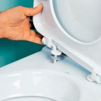 Securing the toilet lid: how to remove the old and install a new seat on the toilet