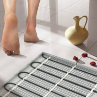Which warm floors are better: water or electric? Comparative review