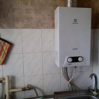 Vājš karstā ūdens spiediens no gāzes kolonnas: spiediena pazemināšanās iemesli + tīrīšanas instrukcijas