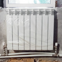 Connecting a heating radiator to a two-pipe system: choosing the best connection option