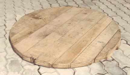 Wooden cover for a well