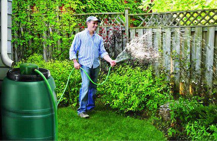 Watering the beds with collected rainwater