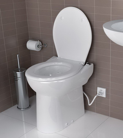 Toilet bowl with integrated pump