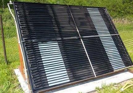 Saulės šildymas privačiame name su atvirais kolektoriais
