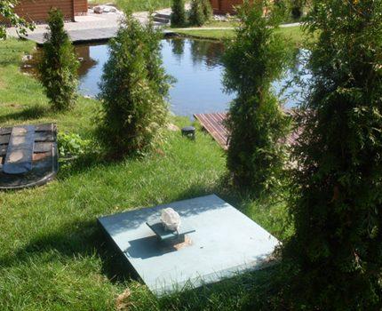 Septic tank near the pond