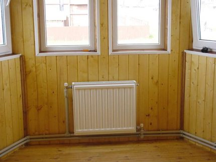 Two-pipe vertical heating system
