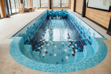 Facing the pool with tiles and mosaics