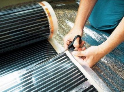 Cutting infrared warm floor into strips for laying under linoleum