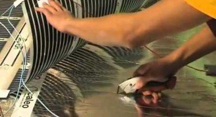 Installation of a film floor heating system