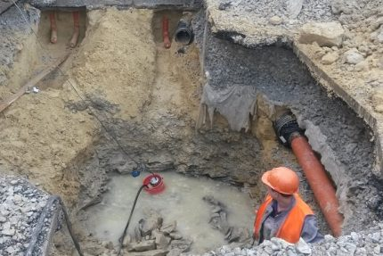 Pumping water from the pit and trenches