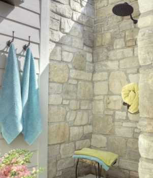 Outdoor shower at the wall of the house