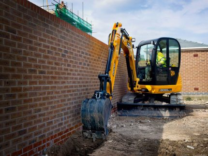 Mini excavator for digging trenches