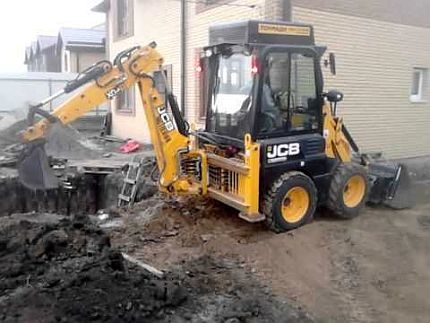 Digging a hole by an excavator