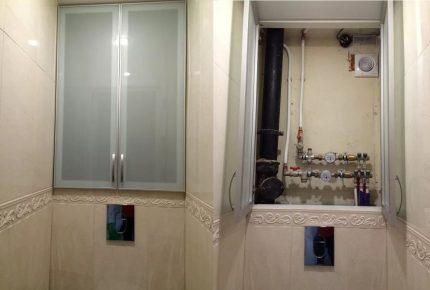 Plumbing cabinet with glass doors