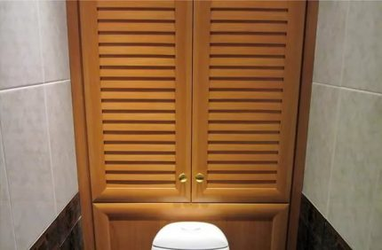 Sanitary cabinet with wooden doors