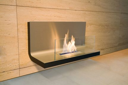 Open fireplace with a protective screen
