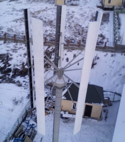 Vertical wind generator on a wooden mast