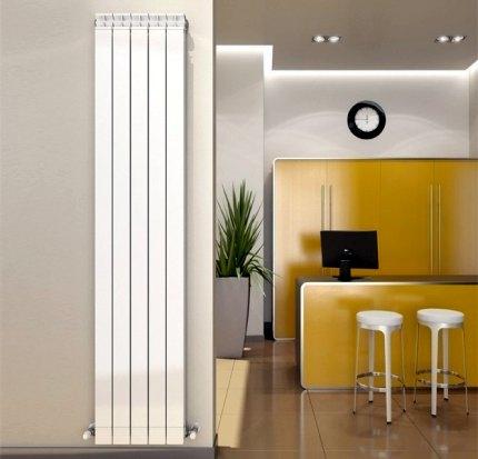 Sekciju vertikālie radiatori