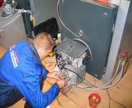 Master repairs a gas boiler