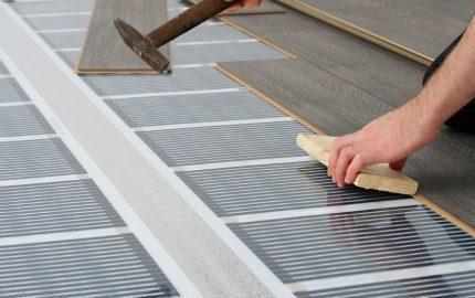 IR floor under the laminate