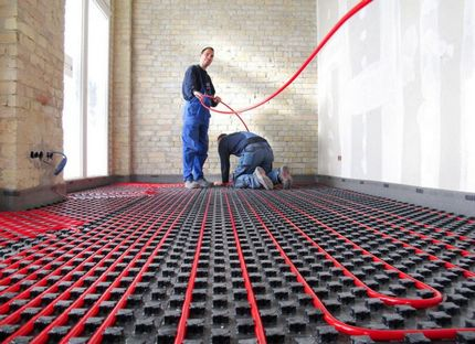 Laying pipes for underfloor heating by professionals