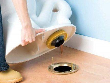 Vertical discharge toilet