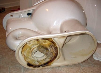 Dismantling an old toilet