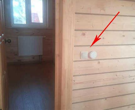 Wireless switch on a wooden wall