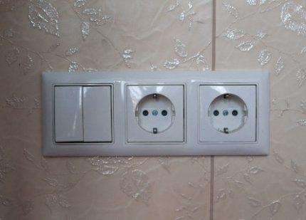 Unité de prise avec interrupteur double