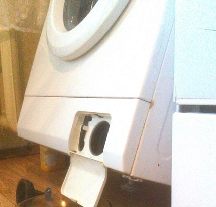 What is the best way to drain the water from the washing machine