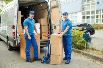 Service center employees transport equipment