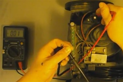Checking the vacuum cleaner button with a tester