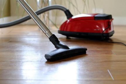 Miele brand vacuum cleaner on the floor