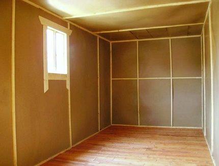 Thermal insulation of fiberboard walls