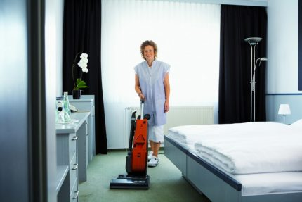 Woman with a quiet vacuum cleaner