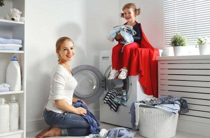 Mom, baby and washing machine