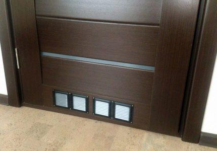 Door with ventilation holes
