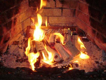 Sawdust briquette burning