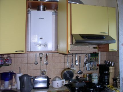 Gas water heater in the interior of the kitchen