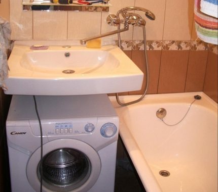 The sink and bath have a common faucet