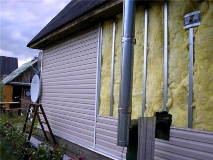 A layer of vapor barrier on the outside of the house