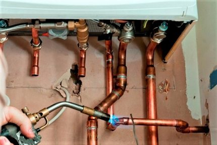 Soldering copper boiler pipes