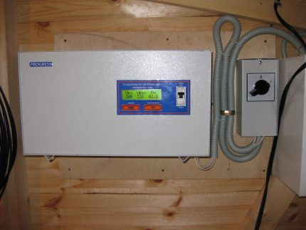 Voltage stabilizer on a wooden wall