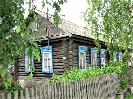 Old wooden house without cladding