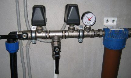Slėgio matuoklis namų vandens tiekimo sistemoje